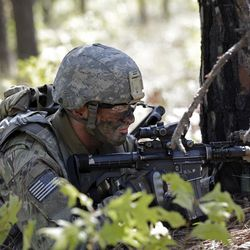 In this photo taken Friday, April 21, 2017, a paratrooper with the 82nd Airborne Division's 3rd Brigade Combat Team participates in a training exercise at Fort Bragg, N.C.  Struggling to expand its ranks, the Army will triple the amount of bonuses it's paying this year to more than $380 million, including new incentives to woo reluctant soldiers to re-enlist, officials told The Associated Press.