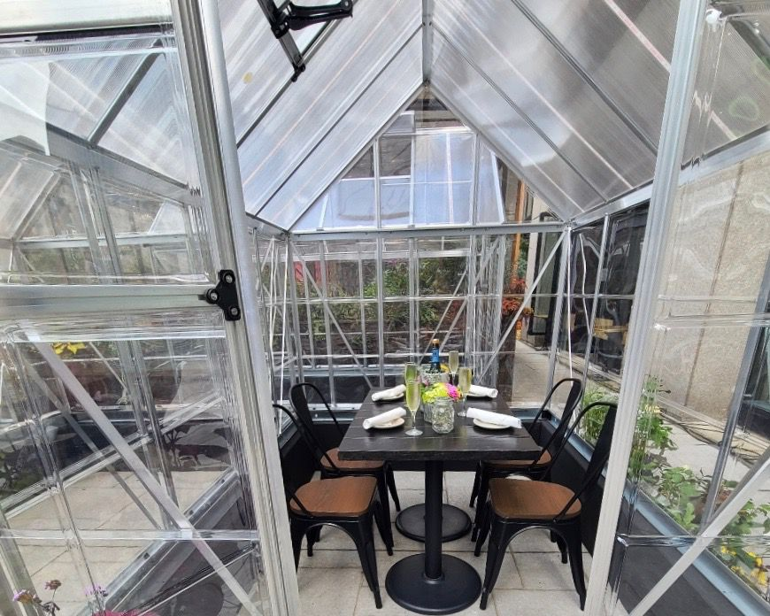 greenhouse with dining table inside