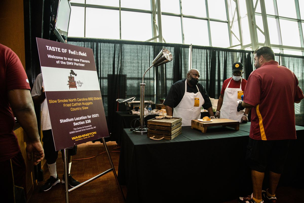 Cooks from EllaRay's cafe showcase their barbecue sandwiches at a Taste of FedEx Field event in June.