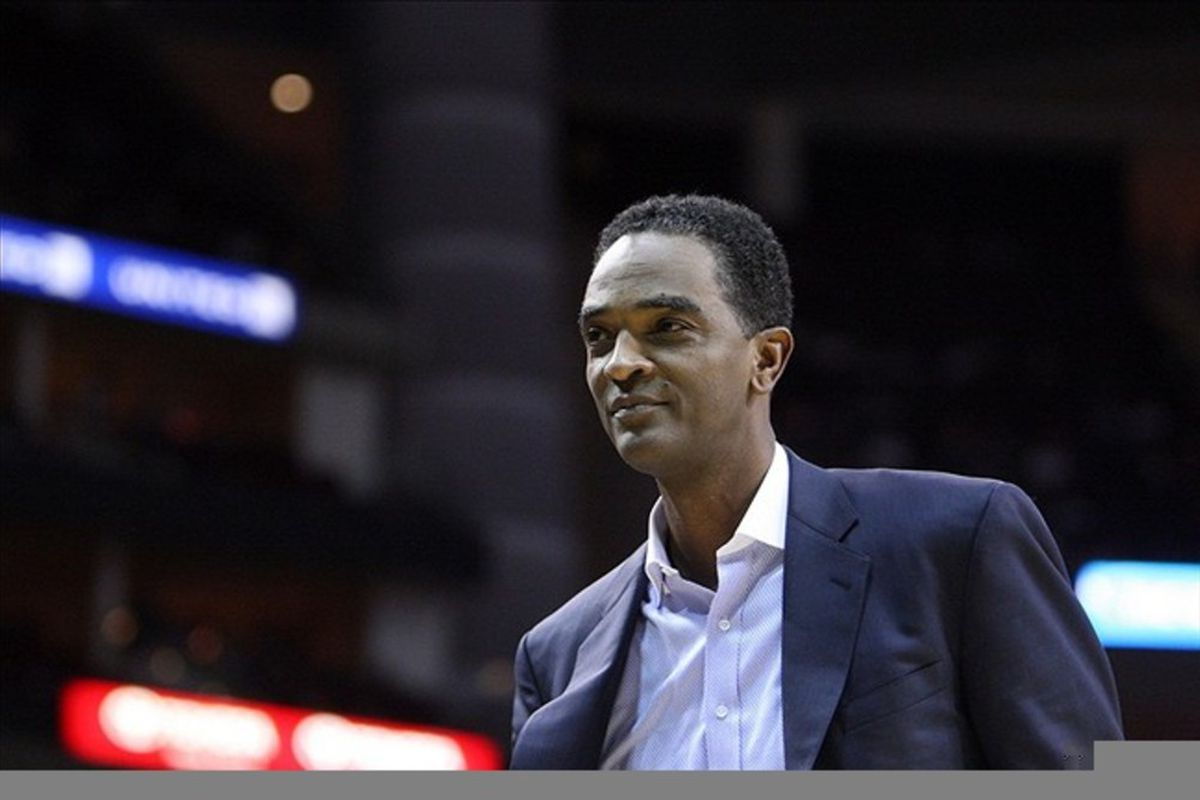 Feb 28, 2012; Houston, TX, USA; Houston Rockets former player Ralph Sampson smiles at fans during the second quarter against the Toronto Raptors at the Toyota Center. Mandatory Credit: Thomas Campbell-US Presswire