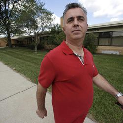 """Jim Manna walks outside the former Eagle Elementary School in West Bloomfield, Mich., Wednesday, Aug. 29, 2012. This affluent Detroit suburb with a diverse mix of religions and races and center of the region's Jewish community is the latest battleground over mosque construction, as some residents push back against a school district's decision to sell a vacant elementary school to an Islamic group. The Farmington Hills school district defends its agreement to sell Eagle Elementary School to a Muslim association and an administrator says opposition now can be classified as """"Islamophobia."""""""