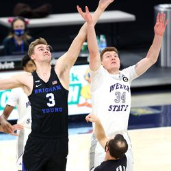 Brigham Young Cougars forward Matt Haarms (3) and Weber State Wildcats forward Cody Carlson (34) tipoff the game as BYU and Weber State play an NCAA basketball game at Vivint Smart Home Arena in Salt Lake City on Wednesday, Dec. 23, 2020.