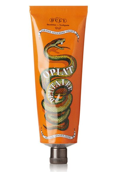 A tube of orange ginger Opiat Dentaire toothpaste