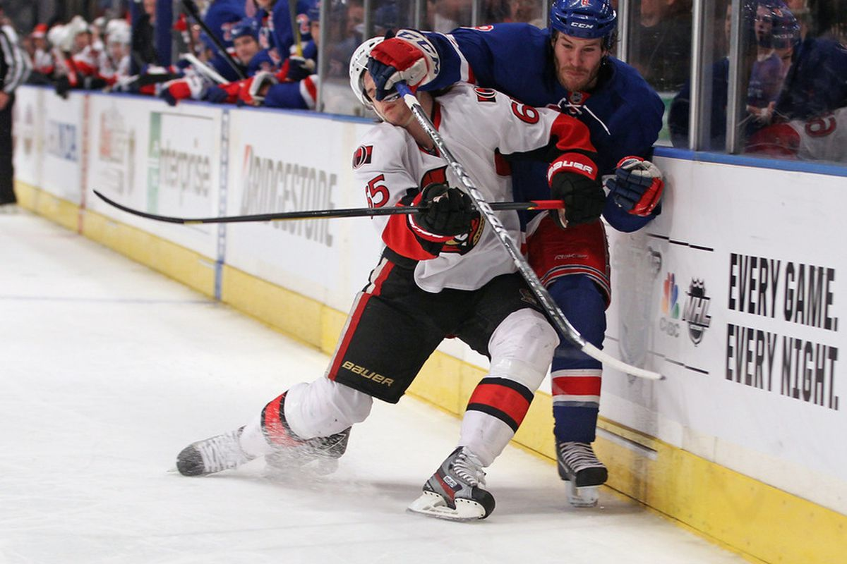 Prust letting Karlsson get a good smell of his glove. (Photo by Bruce Bennett/Getty Images)