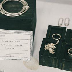 "Linked bangles in sterling silver, <a href=""http://www.farfetch.com/uk/shopping/men/alice-waese-thin-hand-beaten-link-bracelets-item-10413969.aspx?storeid=9081&ffref=pp_recview"">$1,684</a>; Fingers Crossed pendant in sterling silver, $600; Stitch ring in"