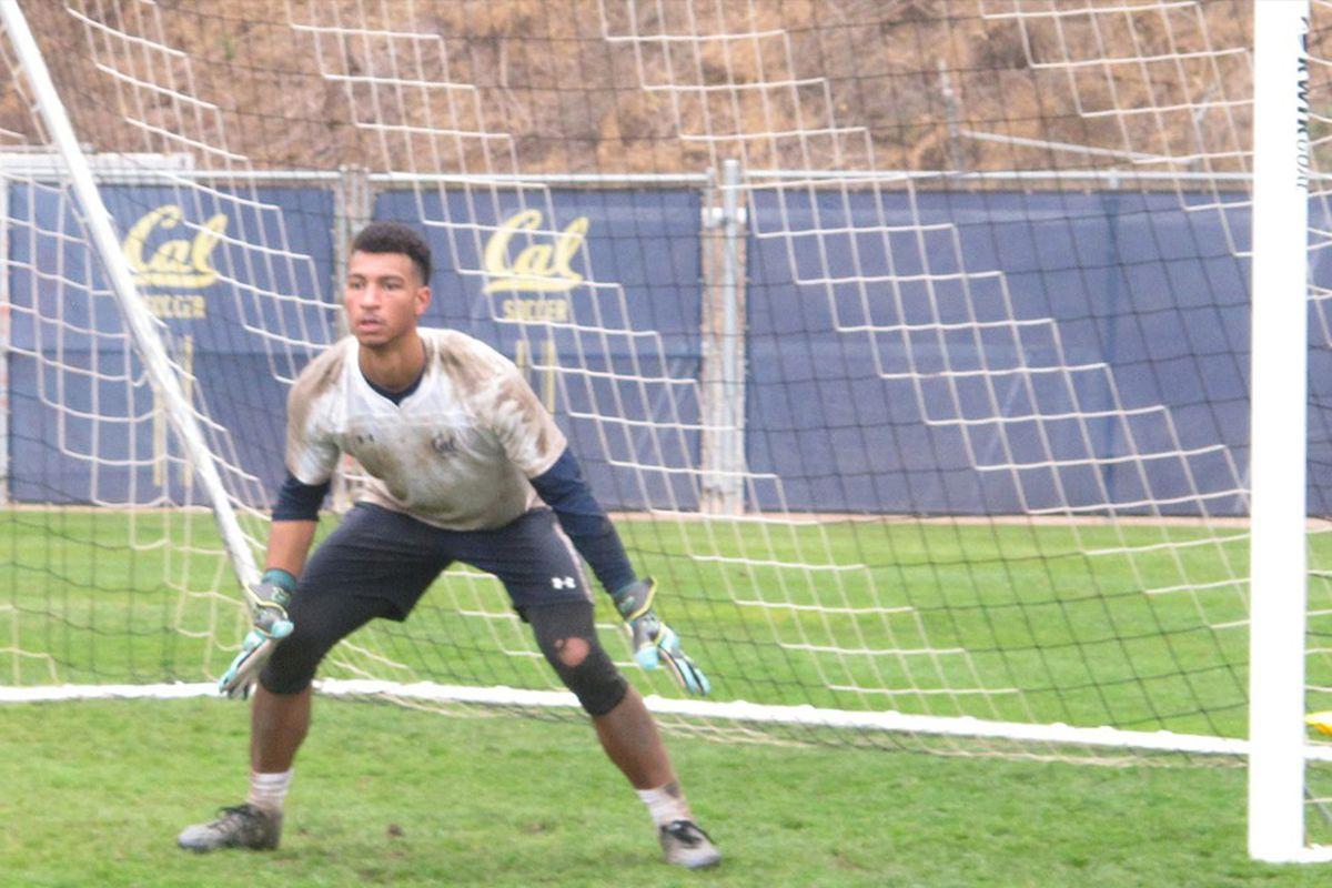 Cal goalkeeper Drake Callender defends his goal in a soccer match.