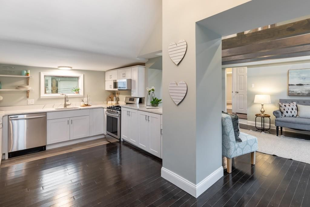 An open kitchen around the corner of a large column.