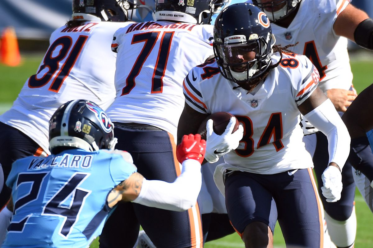 Chicago Bears wide receiver Cordarrelle Patterson runs against Tennessee Titans strong safety Kenny Vaccaro during the first half at Nissan Stadium.