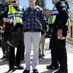 University of Colorado senior Jonathan Edwards is arrested by Boulder County Sheriff deputies for trespassing on Norlin Quad by going past the police tape on the University of Colorado campus in Boulder, Colo., on Friday, April 20, 2012. A block-long line of protesters marched onto the University of Colorado, testing the school's determination to push the annual April 20 marijuana celebration off campus.
