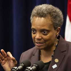Mayor Lori Lightfoot speaks with reporters after her first Chicago City Council meeting at City Hall, Wednesday, May 29, 2019.