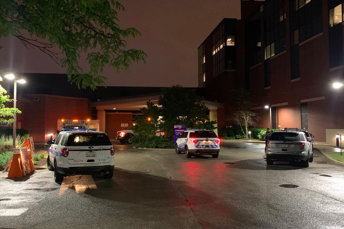 Chicago police SUVs wait outside West Suburban Medical Center in Oak Park June 20, 2020, where a 3-year-old boy was taken after being shot while riding in a car with his father in Austin. The boy later died.
