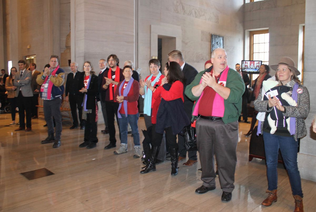 Teachers line a hall at the state Capitol to cheer for lawmakers as a voucher bill fails in 2016.