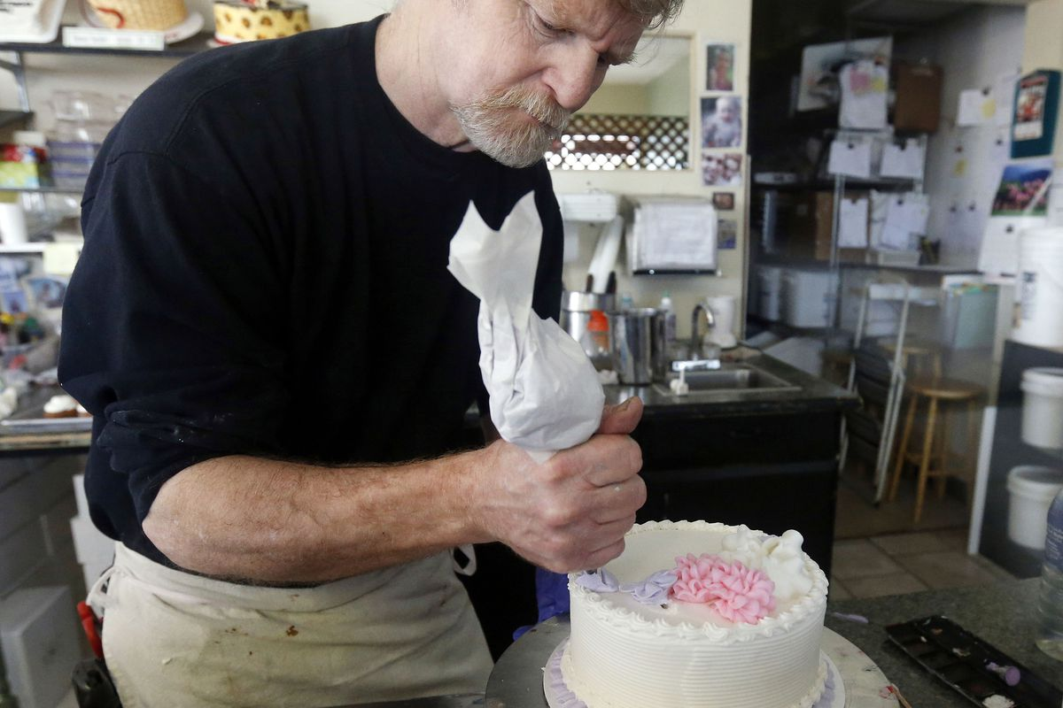 FILE - In this March 10, 2014, file photo, Masterpiece Cakeshop owner Jack Phillips decorates a cake inside his store in Lakewood, Colo. Salt Lake City Mayor Jackie Biskupski is among mayors and cities across the country urging the U.S. Supreme Court to b