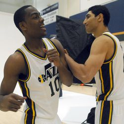 The Jazz's Alex Burks, left, goofs around with teammate Enes Kanter in between photos during media day at the Zions Bank Basketball Center on Sept. 30.