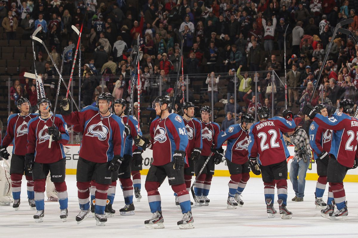 DENVER, CO - DECEMBER 21:  The Colorado Avalanche salute their fans as they celebrate their 3-2 victory over the St. Louis Blues at the Pepsi Center on December 21, 2011 in Denver, Colorado.  (Photo by Doug Pensinger/Getty Images)