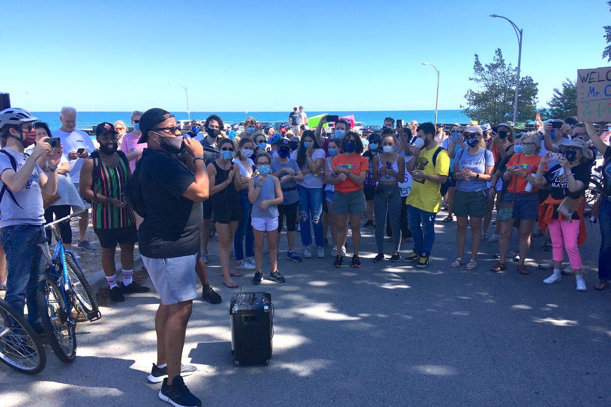Otis Campbell speaks at a rally at Winnetka pier on Sept 5, 2020.
