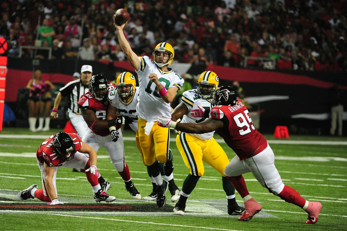 ATLANTA, GA - OCTOBER 9: Aaron Rodgers #12 of the Green Bay Packers passes against the Atlanta Falcons at the Georgia Dome on October 9, 2011 in Atlanta, Georgia. (Photo by Scott Cunningham/Getty Images)