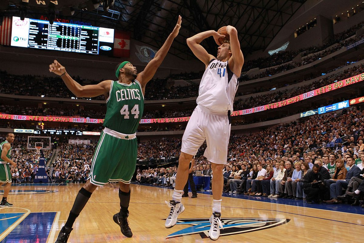 Dirk Nowitzki #41 of the Dallas Mavericks takes a shot against Chris Wilcox #44 of the Boston Celtics at American Airlines Center on February 20, 2012 in Dallas, Texas.  (Photo by Ronald Martinez/Getty Images)