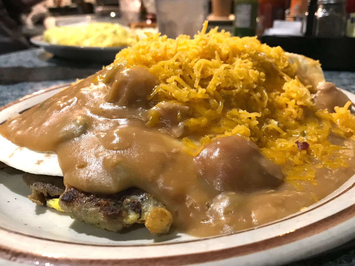 Mexican burger smothered in green chile and cheese