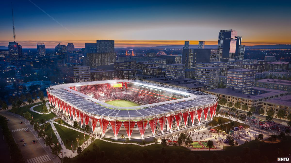 A rendering of a forthcoming soccer stadium in downtown Sacramento, surrounded by a red, star-patterned facade.