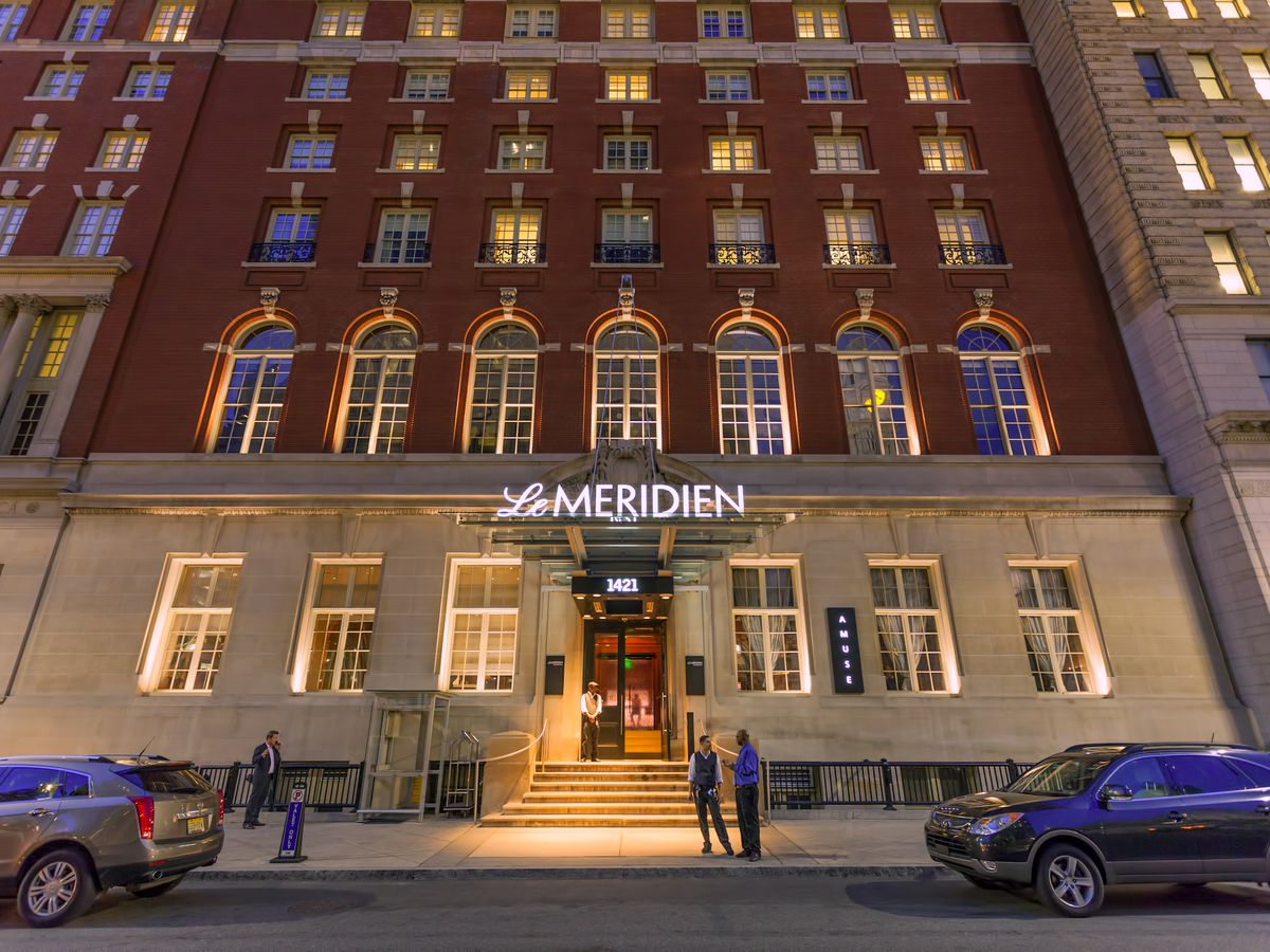 The exterior of Le Meridien Philadelphia. The facade is red brick and the lower level is stone.