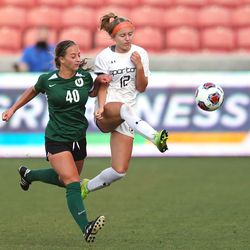 Olympus' Fifi Ward runs with Murray's Aly Starbuck as she kicks the ball out of bounds during 5A state semifinal action at Rio Tinto Stadium in Sandy on Tuesday, Oct. 20, 2020. Olympus won 2-1 to advance to the championship game.