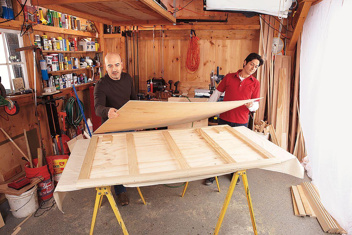 Men Attaching Sheathing Of Home Bar