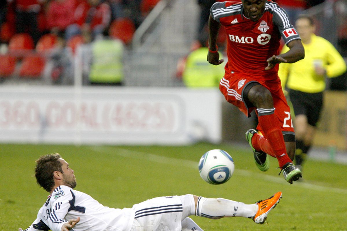 TORONTO, CANADA - MAY 14: Tony Tchani #22 of Toronto FC gets tripped up by Daniel Paladini #11 of Chicago Fire during MLS action at BMO Field May 14, 2011 in Toronto, Ontario, Canada. (Photo by Abelimages/Getty Images)