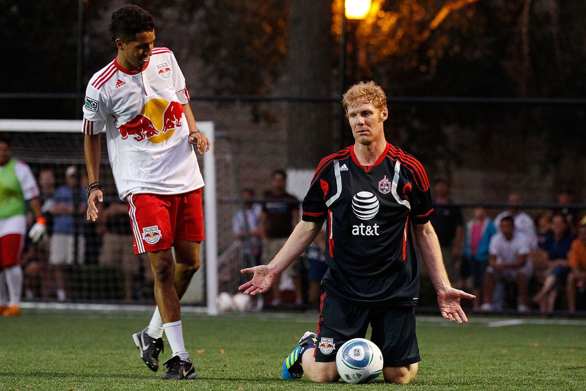 HARRISON, NJ - JULY 25:  Former player Alexi Lalas reacts after being knocked to the ground during the MLS All-Star - Legends Game on July 25, 2011 at Harrison Fields in Harrison, New Jersey.  (Photo by Mike Stobe/Getty Images for New York Red Bulls)