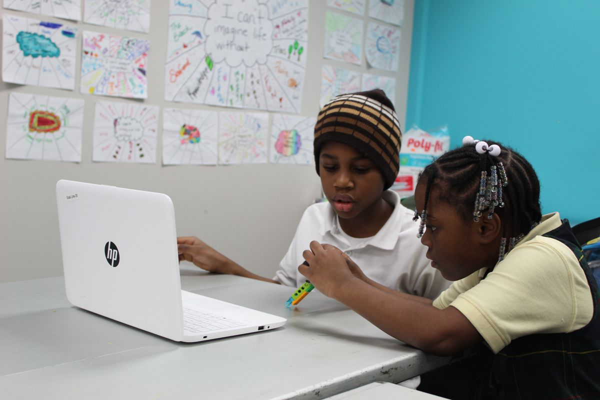 A free after school program offered by the GOAL Line includes lessons in robotics (seen here), swimming, and gymnastics.