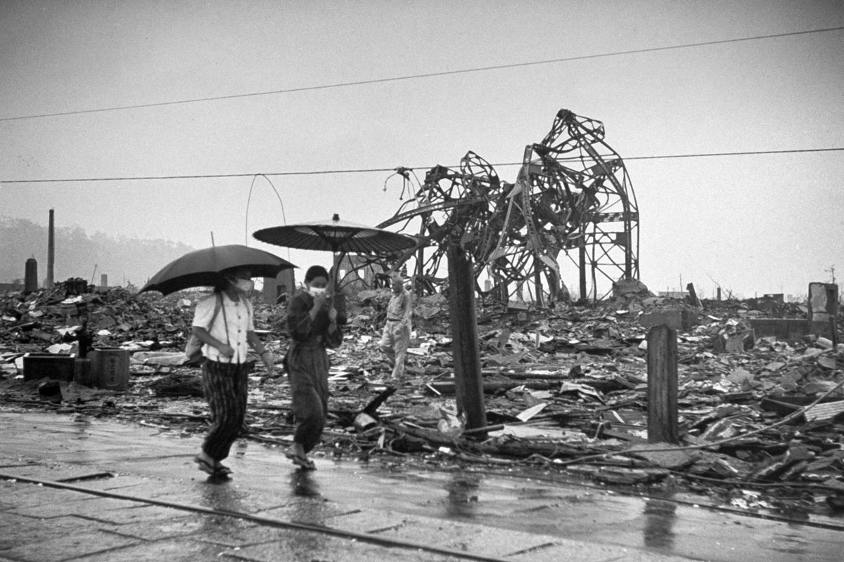 People walking through the ruins of Hiroshima in the weeks following the atomic bomb blast.