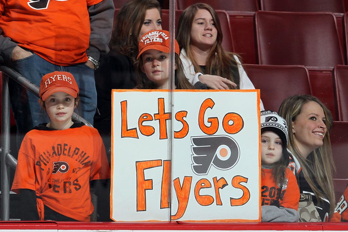 PHILADELPHIA PA - JANUARY 20:  Fans of the Philadelphia Flyers look on as their team warms up before playing against the Ottawa Senators on January 20 2011 at Wells Fargo Center in Philadelphia Pennsylvania.  (Photo by Jim McIsaac/Getty Images)