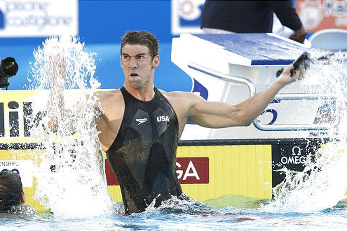 Michael Phelps of the United States reacts after breaking the world record in the 100-meter butterfly in Rome.