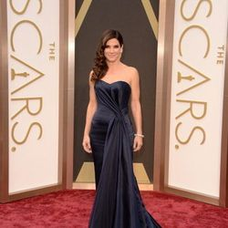Sandra Bullock, nominated for best actress for <em>Gravity</em> wore a deep navy blue Alexander McQueen gown, which can be found at Wynn Las Vegas.