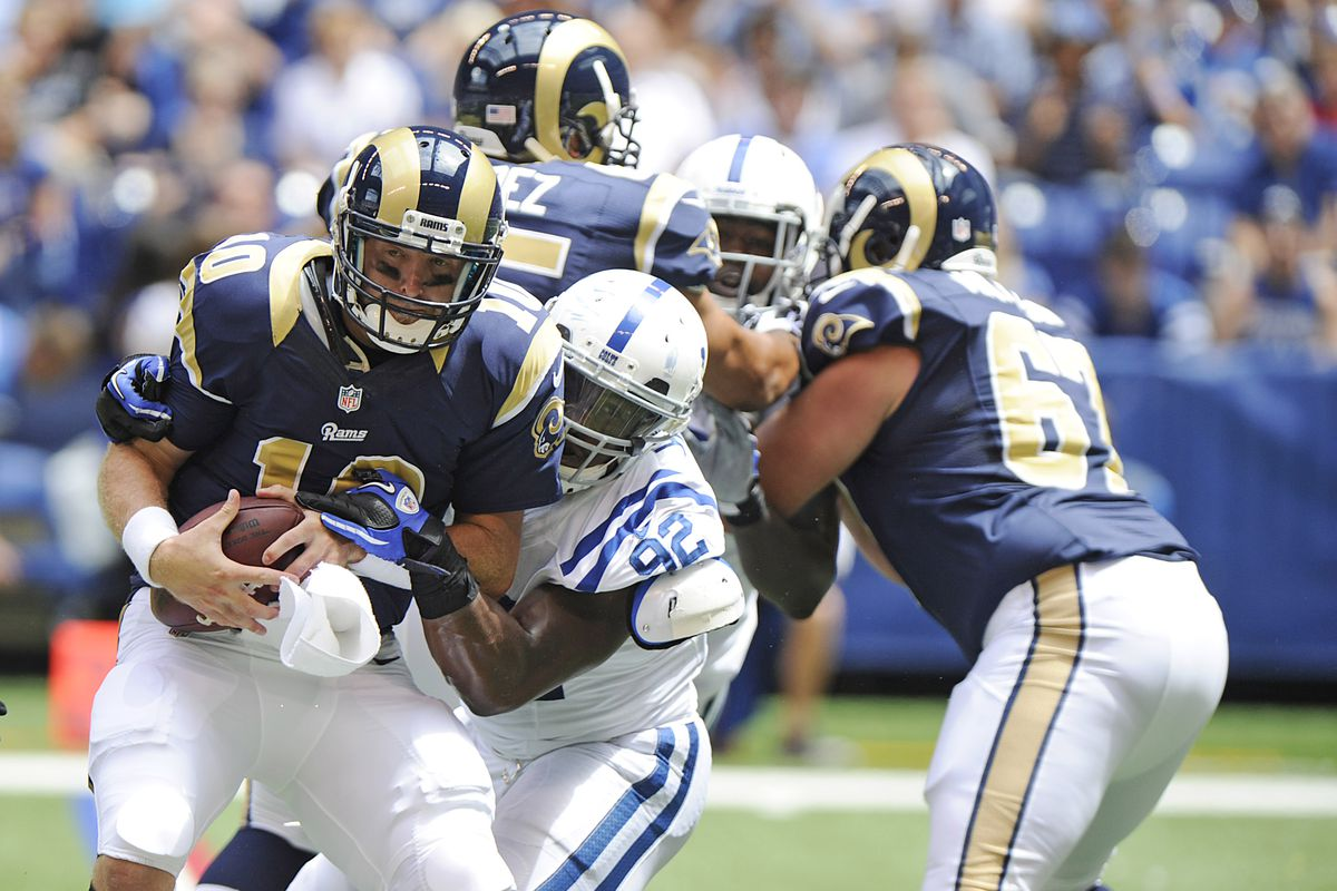 August 12, 2012; Indianapolis, IN USA;  Indianapolis Colts defensive end Jerry Hughes (92) sacks St. Louis Rams quarterback Kellen Clemens (10) during the second quarter of play in Lucas Oil Stadium.  Mandatory Credit: Jamie Rhodes-US PRESSWIRE