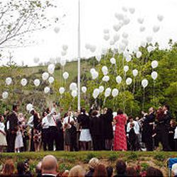 Olive Osmond's grandchildren release balloons with good wishes and thoughts for their grandmother at her graveside at East Lawn Memorial Gardens in Provo Saturday.