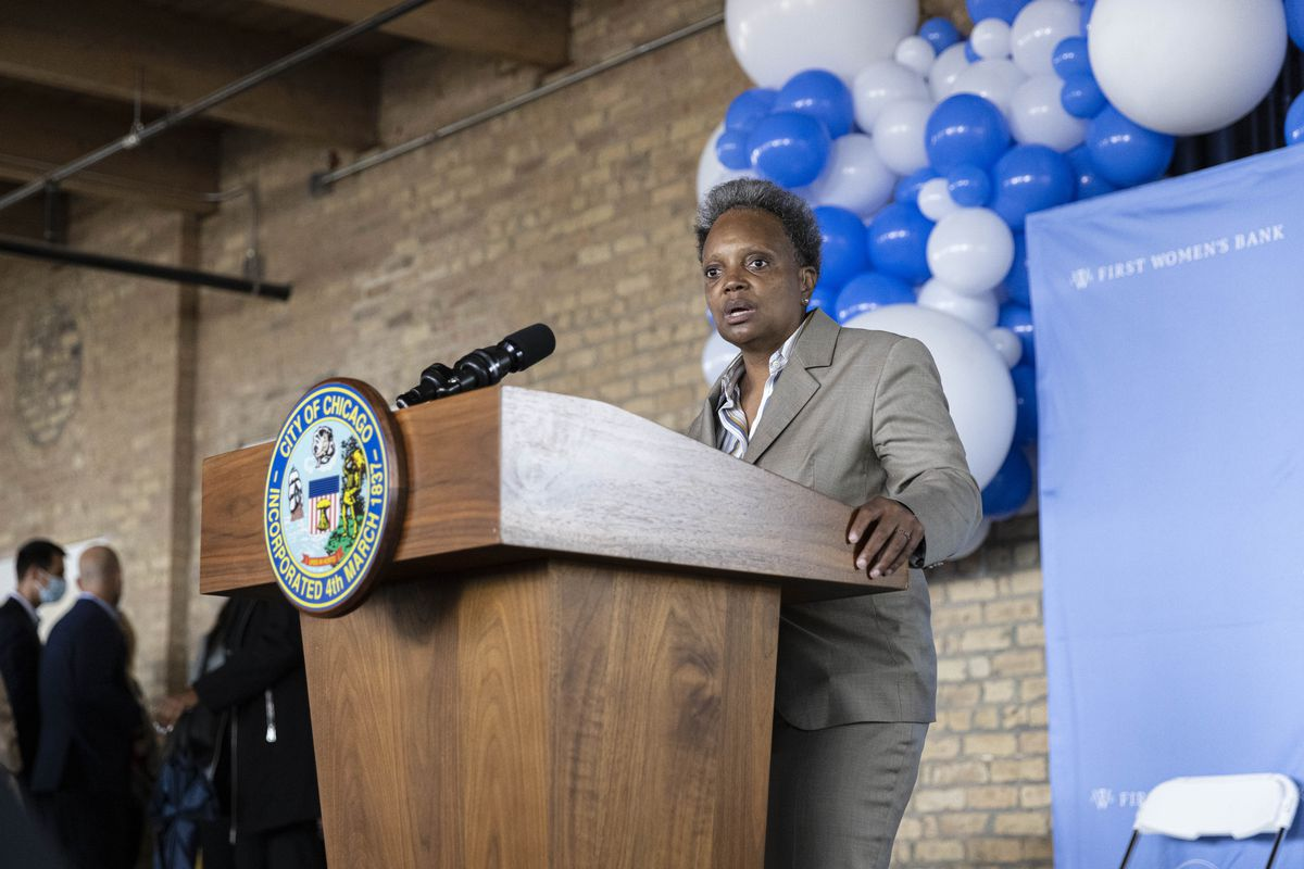 Mayor Lori Lightfoot answers questions from the press after a ribbon-cutting ceremony at the First Women's Bank at 1308 N. Elston Ave. in Goose Island, Wednesday, Sept. 22, 2021.
