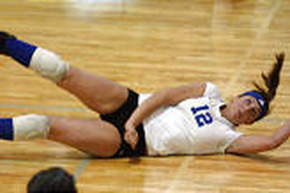 Pleasant Grove's Hailey Jeppson dives for the ball against Morgan during Tuesday's volleyball match at Pleasant Grove High School.