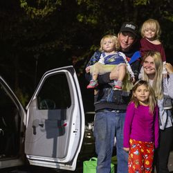 Crissy Norton, right, and husband Matthew Branstetter stand for a photo with their daughters Julie, 1, Adrianna, 3, and Lucy, 6, at Lake Washington United Methodist Church in Kirkland, Wash., on Sunday, Oct. 13, 2019. The family has been using the Safe Parking program for the past several months, first becoming homeless in December 2018. During the day, Norton takes care of her young daughters while her oldest attends school. Branstetter, who has been doing Instacart deliveries, is waiting to hear back about millwrightposition.