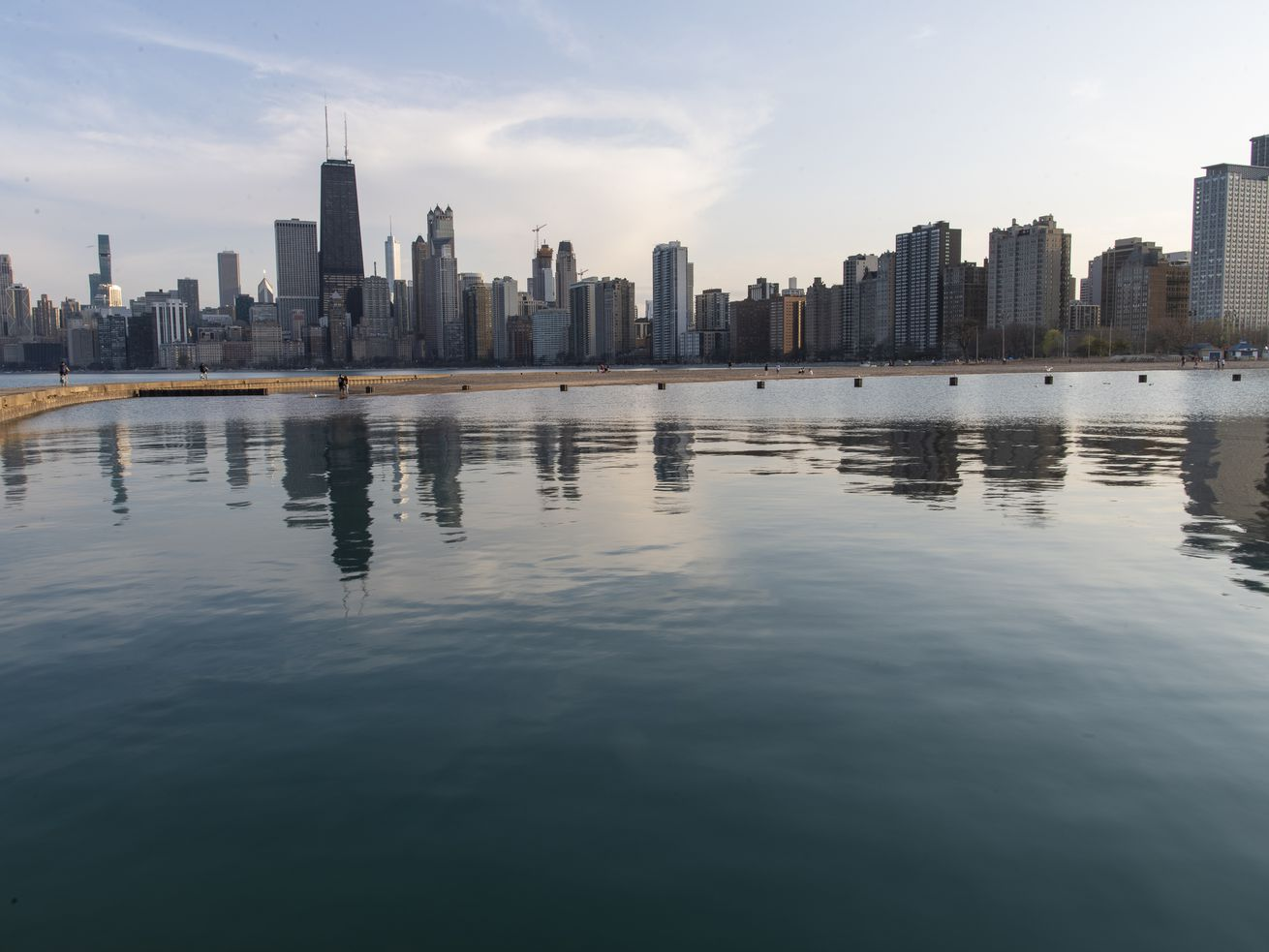 Chicago Skyline seen on a path that juts out into Lake Michigan near North Avenue Beach on April 7, 2021.