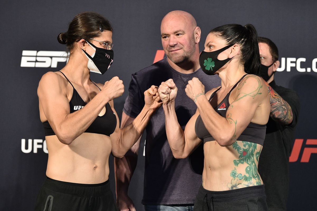 In this handout image provided by UFC, opponents Roxanne Modafferi and Lauren Murphy face off during the UFC weigh-in at UFC APEX on June 19, 2020 in Las Vegas, Nevada.