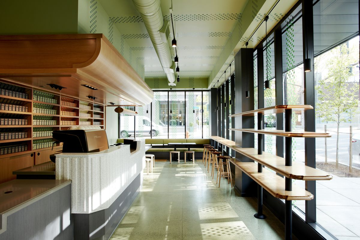 The hallway at Smith Teamaker's tea shop is long, with green walls and oak built-ins. The window walls look out onto the street.