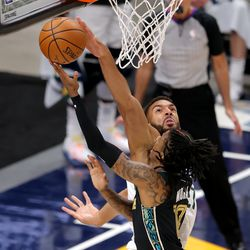 Utah Jazz center Rudy Gobert (27) blocks Memphis Grizzlies guard Ja Morant (12) as the Utah Jazz and the Memphis Grizzlies play in game one of their NBA playoff series at Vivint Arena in Salt Lake City on Sunday, May 23, 2021.