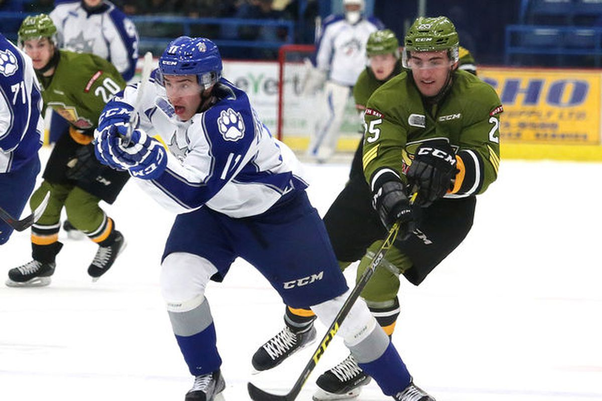 Alan Lyszczarczyk, left, of the Sudbury Wolves, and Mark Shoemaker, of the North Bay Battalion, battle for the puck during OHL action at the Sudbury Community Arena in Sudbury, Ont. on Friday November 13, 2015. John Lappa/Sudbury Star/Postmedia Netwo