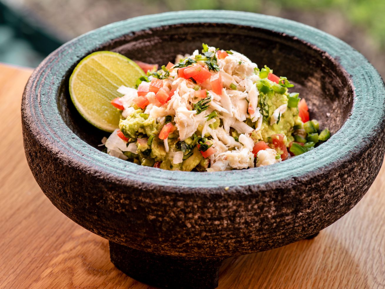 Adding crab to the guacamole mix at Lona.