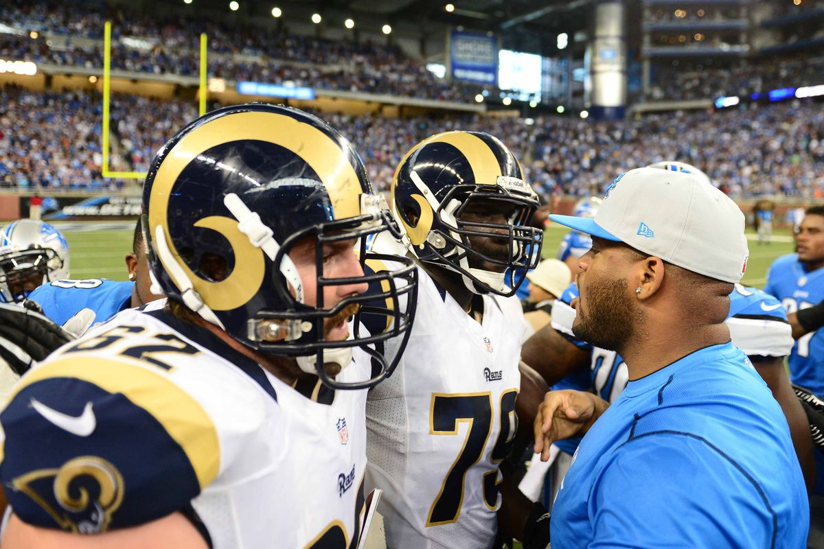 Sep 9, 2012; Detroit, MI, USA; St. Louis Rams guard Harvey Dahl (62) and tackle Rokevious Watkins (73) argue with a Detroit Lions player following the game at Ford Field. Mandatory Credit: Andrew Weber-US Presswire