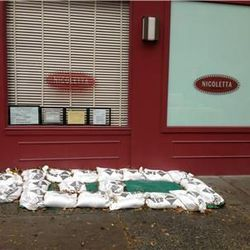 """Sandbags at Nicoletta. [<a href=""""http://eastvillage.thelocal.nytimes.com/2012/10/29/liveblog-east-village-braces-for-hurricane-sandy/"""">The Local</a>]"""