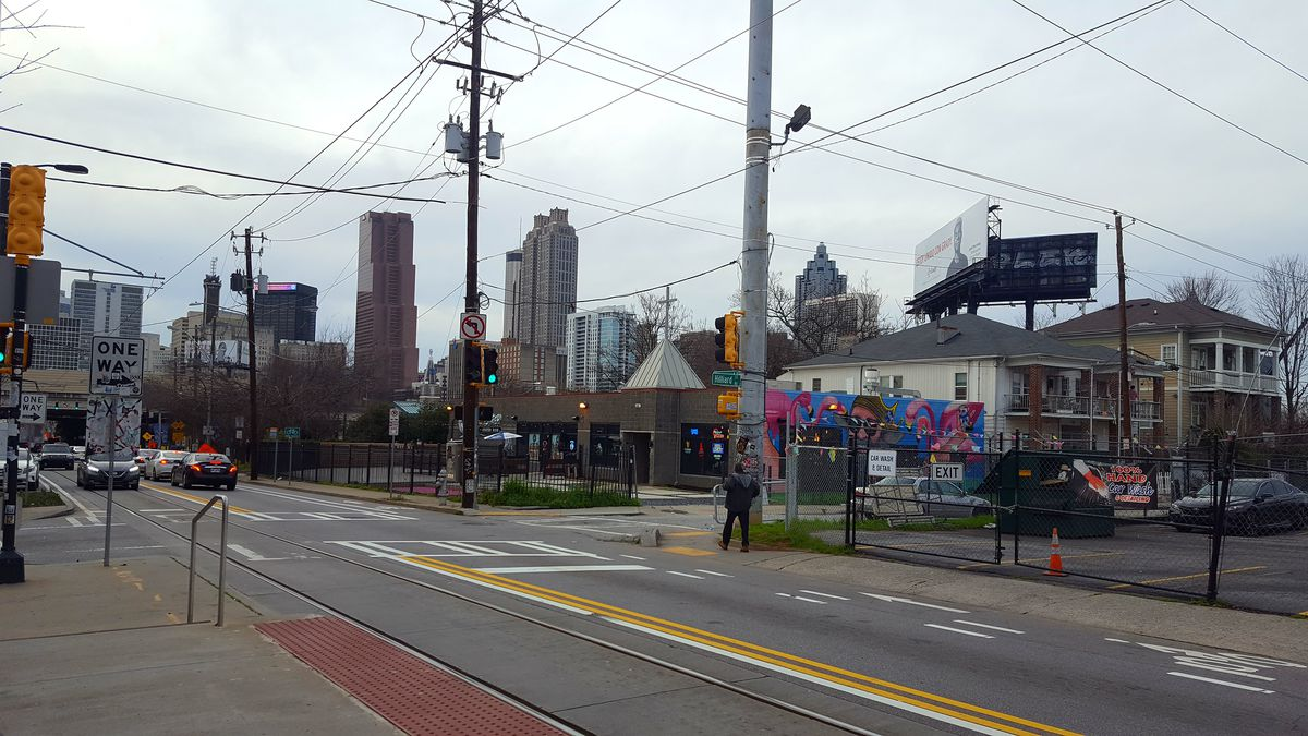 A downtown skyline view hovers over a bar on Edgewood Avenue.