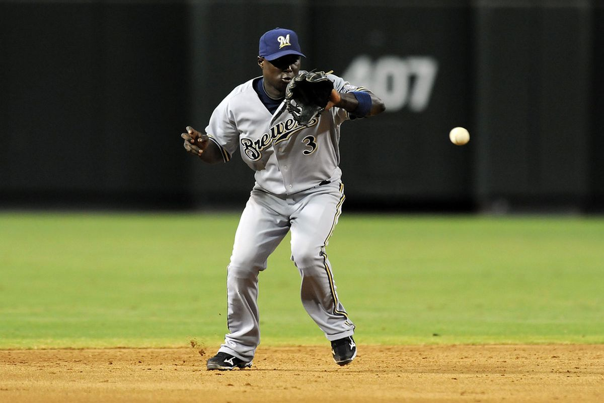 PHOENIX, AZ - JULY 21:  Yuniesky Betancourt #3 of the Milwaukee Brewers makes a play on a ground ball against the Arizona Diamondbacks at Chase Field on July 21, 2011 in Phoenix, Arizona.  (Photo by Norm Hall/Getty Images)