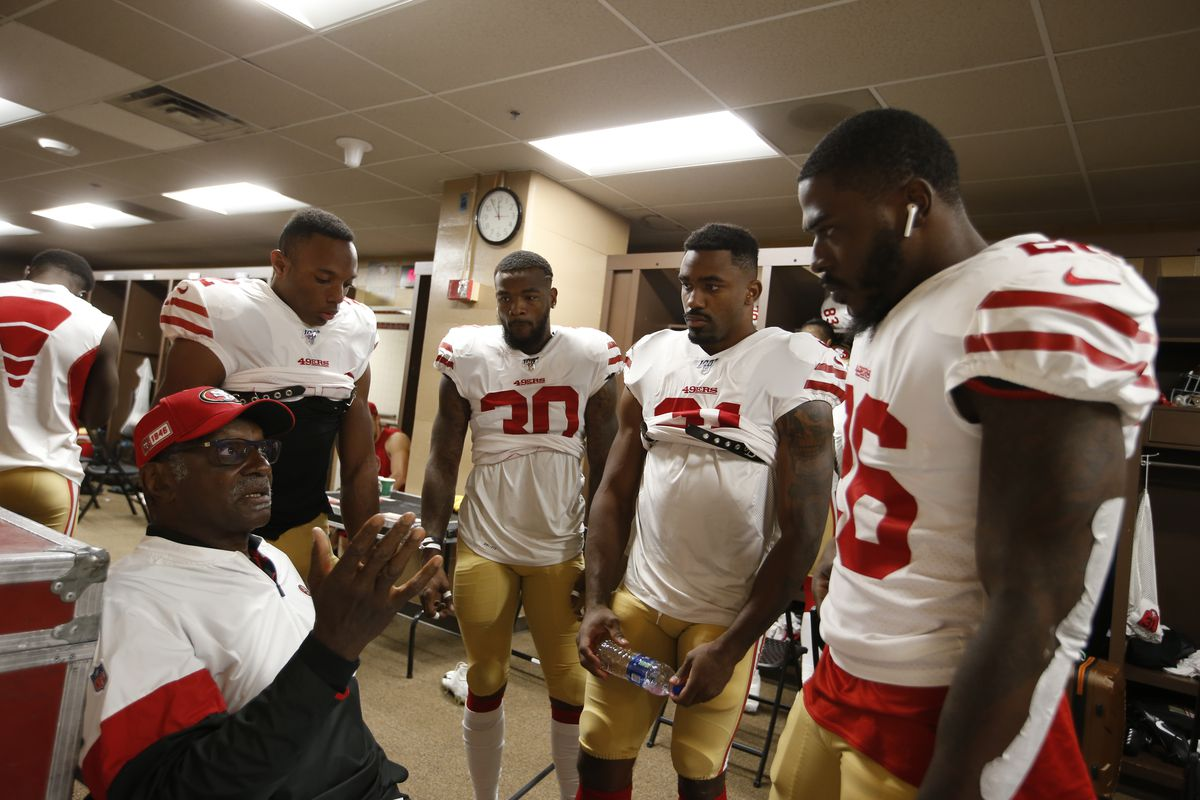 Running Backs Coach Robert Turner Jr. of the San Francisco 49ers talks with Matt Breida, Jeff Wilson Jr., Raheem Mostert and Tevin Coleman in the locker room prior to the game against Washington at FedExField on October 20, 2019 in Landover, Maryland.